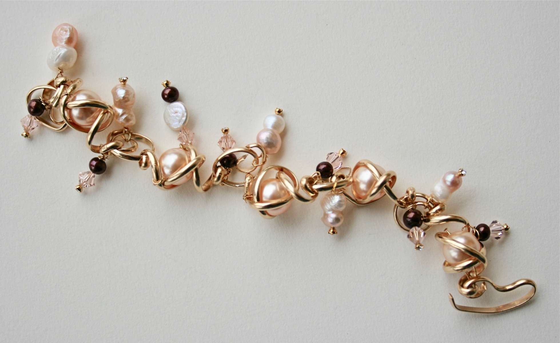 Twists and turns charm bracelet, Gold-filled
