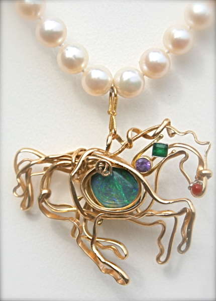 Horse pendant with gemstones and pearl necklace